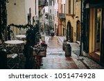 rainy streetview of spoleto  a...   Shutterstock . vector #1051474928