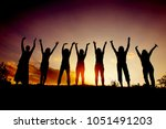 group of people waving their... | Shutterstock . vector #1051491203