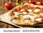traditional neapolitan pizza | Shutterstock . vector #1051494194