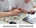 a boy teenager with a teacher... | Shutterstock . vector #1051495148