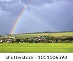 Rainbow over a green field...