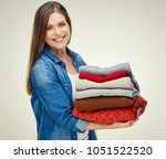 woman housekeeper holding stack ... | Shutterstock . vector #1051522520