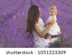 happy mother with little... | Shutterstock . vector #1051523309