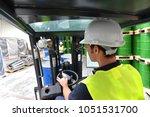 forklift driver in a logistics... | Shutterstock . vector #1051531700