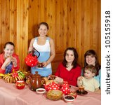 Happy family  drinking tea with russian traditional snack - stock photo