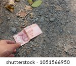 a hand reaching out to pick...   Shutterstock . vector #1051566950