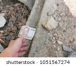 a hand reaching out to pick...   Shutterstock . vector #1051567274
