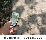 a hand reaching out to pick...   Shutterstock . vector #1051567838