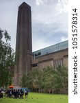 Small photo of LONDON, ENGLAND - JUNE 15 2016: Building of Tate Modern Gallery near Thames River, London, United Kingdom