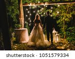 night wedding ceremony with... | Shutterstock . vector #1051579334