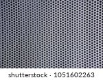 grey metal perforated sheet | Shutterstock . vector #1051602263