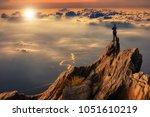 businessmen stand on high peaks ... | Shutterstock . vector #1051610219