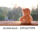 teddy bear toy alone on wood | Shutterstock . vector #1051627058