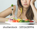 unhappy asian women is on... | Shutterstock . vector #1051628996