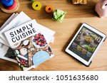 tablet and magazines on table | Shutterstock . vector #1051635680