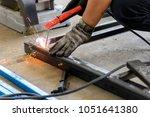 the welding operator welding... | Shutterstock . vector #1051641380