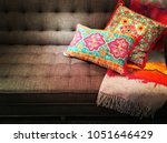textile sofa decorated with... | Shutterstock . vector #1051646429