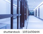 corridor of a large corporate... | Shutterstock . vector #1051650644