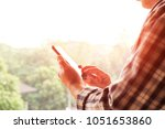 close up of a man using mobile... | Shutterstock . vector #1051653860