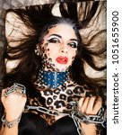 young sexy woman with leopard... | Shutterstock . vector #1051655900