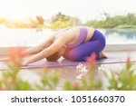 portrait of woman playing yoga... | Shutterstock . vector #1051660370
