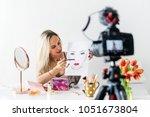 beauty blogger recoding makeup... | Shutterstock . vector #1051673804