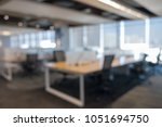 abstract blur business office... | Shutterstock . vector #1051694750