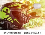 Small photo of Touring Adventure Helmet and Leather Gloves on the Touring Motorcycle. Prepared for the Long Vacation Trip, Biker Lifestyle.