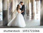 dream like portrait of newlywed ... | Shutterstock . vector #1051721066