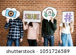 friends holding up thought... | Shutterstock . vector #1051726589