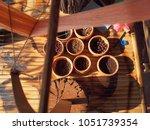 multisize bead put on wooden... | Shutterstock . vector #1051739354