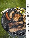 barbecue a hot summer evening ... | Shutterstock . vector #105174020
