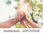 people join hands together... | Shutterstock . vector #1051747010