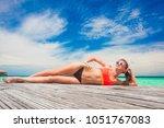 back view of woman in bikini... | Shutterstock . vector #1051767083