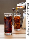 glass of cold brew iced coffee... | Shutterstock . vector #1051771970