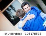 father congratulating his son...   Shutterstock . vector #105178538