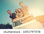 group of happy friends in a car ...   Shutterstock . vector #1051797578