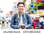smiling young happy asian male... | Shutterstock . vector #1051802363