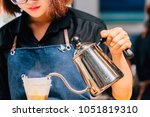 women barista to make a drip... | Shutterstock . vector #1051819310