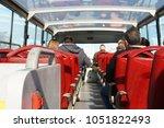 tourists in double decker hop... | Shutterstock . vector #1051822493