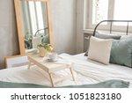 interior shot of made bed in... | Shutterstock . vector #1051823180