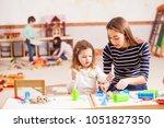 the teacher is teaching the... | Shutterstock . vector #1051827350