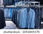 rack with suit jackets in... | Shutterstock . vector #1051845170