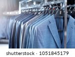 rack with suit jackets in... | Shutterstock . vector #1051845179