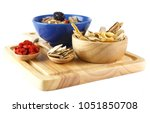 chinese herbals on wooden spoon ... | Shutterstock . vector #1051850708