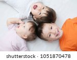 happy kids  three laughing... | Shutterstock . vector #1051870478