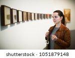 portrait of positive young... | Shutterstock . vector #1051879148