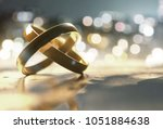 rings lay on table  3d... | Shutterstock . vector #1051884638