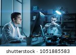 engineering team working in the ... | Shutterstock . vector #1051885583