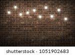 shining light bulbs on dark... | Shutterstock . vector #1051902683